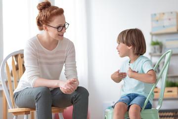 Boy talking with child psychotherapist