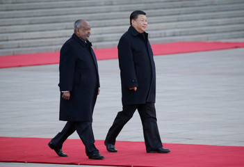 Chinese President Xi Jinping and Djibouti's President Ismail Omar Guelleh take part in a welcoming ceremony at the Great Hall of the People in Beijing