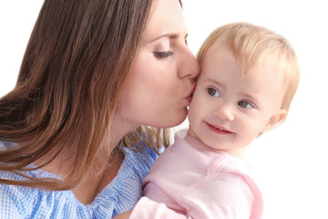 Young mother holding cute baby at home