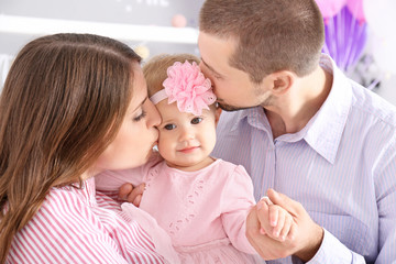 Young family and cute baby at home