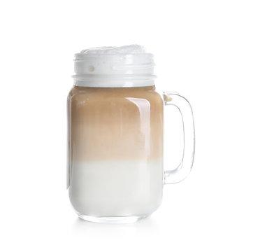 Mason jar with latte macchiato on white background