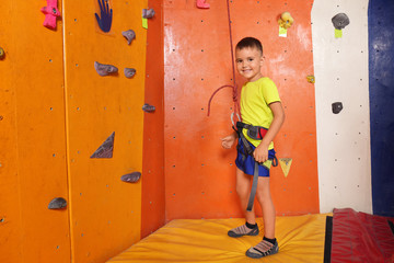 Adorable little boy in climbing gym