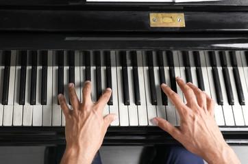Young man playing piano, closeup