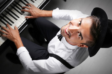 Young man playing piano, top view