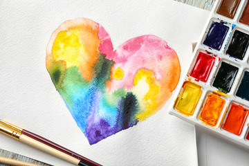 Painting of rainbow heart and watercolors, closeup