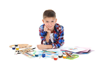 Cute little boy with art supplies on white background