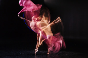 Printed roller blinds Dance School Good preparation. Serious nice professional performer standing on the stage and practicing dance movements while rehearsing
