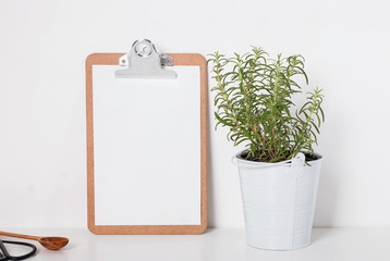 Clipboard mock-up with green rosemary plant