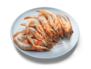 Plate with fresh shrimps on white background