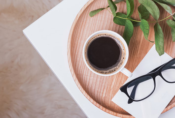 Coffee and glasses on the small coffee table