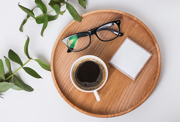 Coffee and glasses on the wooden tray