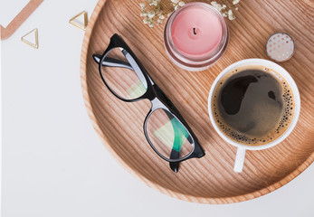 Coffee, glasses and other small items on the wooden tray