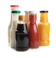 Printed roller blinds Spices Bottles with different sauces for salad on white background