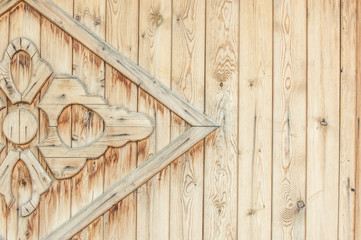 Texture, background, pattern. Part of the wooden gate decorated with patterns