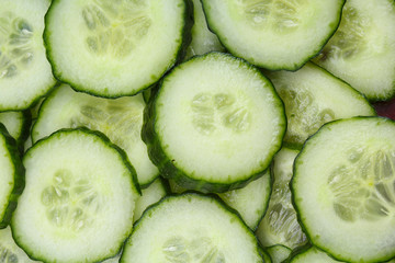 Cucumber slices as background. Green fresh cucumbers as background. Cucumber pattern texture. Vegetable food photo. Texture background.