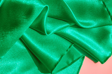 Texture, fabric, background. Abstract background of luxurious fabric or liquid waves or wavy grunge crease silk satin texture of velvet material or luxurious Christmas or elegant background. green