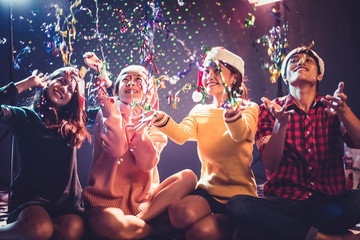 Group of Asian young peoples who celebrating Christmas and New Year. Holiday and Happiness concept. Friendship and Relax theme.