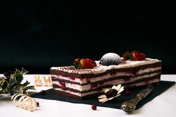 Delicious Christmas cake with fresh strawberries
