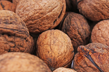 Walnut texture. Brown big walnuts as background. walnut nuts pattern close up photo. Walnuts with shells.