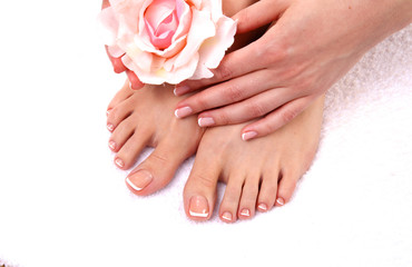 Foto auf Leinwand Maniküre pedicure on legs and beautiful manicure on hands closeup
