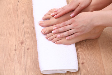 pedicure on legs and beautiful manicure on hands closeup