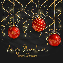Red Christmas balls and golden decorations on black chalkboard background