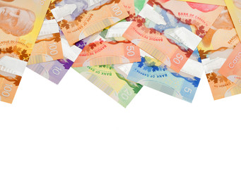 Canadian banknotes on white background