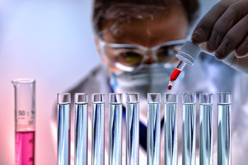 Chemical analyzing different substances in the laboratory front