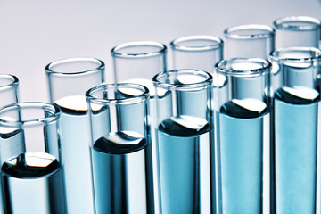Row of full test tubes background