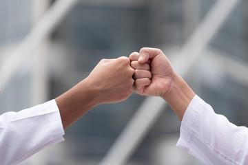 arabian businessman giving  fist bump