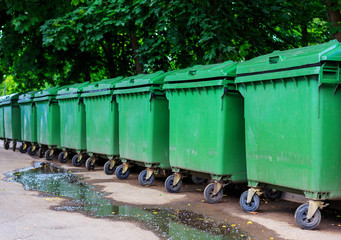 Trash cans standing in a row