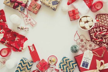 Christmas background with handmade presents wrapped in craft paper, cup of hot chocolate. Flat lay. Space for copy