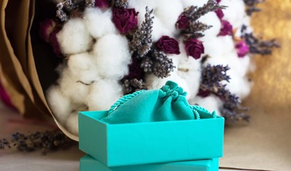 Turquoise box for present on flower background