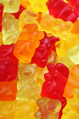 Gummy bear background. Gummy bears as texture. Gum bear candy colorful pattern. Texture background.