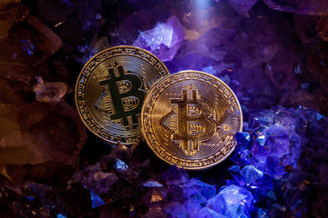 Silver and golden bitcoin in a cave of gem stones