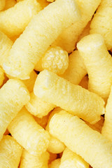 Cheese puff. Cheese puffs snack background texture food pattern. Texture background.