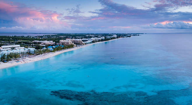 aerial panoramic view of seven mile beach in the tropical paradise of the cayman islands in the caribbean sea after sunset
