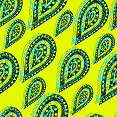 Indian oriental seamless pattern in the form of lacy green drops on a yellow background in ethnic style for decorating fabrics