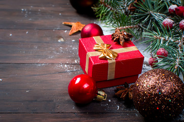 Red christmas  gift  box with red ribbon and fir branches