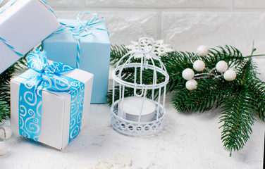 Christmas fir branches and gifts boxes on white background.