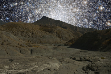 Mountains ridges on the background of outer space stars