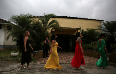 """Prisoners and participants of the """"TB Girl"""" beauty contest walk to the runway at the Talavera Bruce women prison in Rio de Janeiro"""