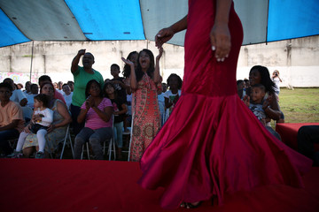 """Relatives of prisoners cheer during """"TB Girl"""" beauty contest at the Talavera Bruce women prison in Rio de Janeiro"""