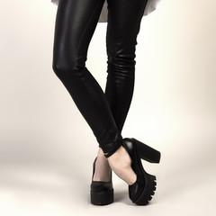 Long woman legs in skinny leather pants and high heels