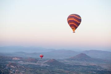 Fotobehang Rudnes Hot air balloons over mountain landscape in Cappadocia, Goreme National Park, Turkey.