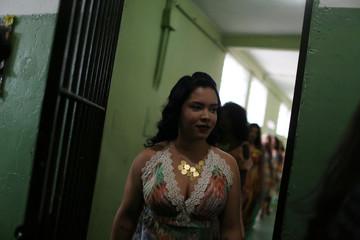 "Prisoners and participants of the ""TB Girl"" beauty contest walk at the Talavera Bruce women prison in Rio de Janeiro"