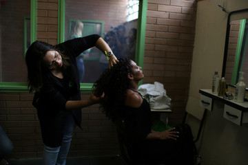 """A prisoner and participant of the """"TB Girl"""" beauty contest has her hair fixed at the Talavera Bruce women prison in Rio de Janeiro"""