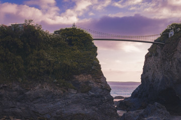 Sunset behind bridge and cliff