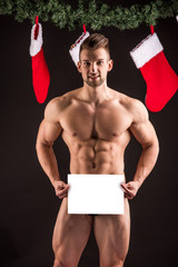 Naked handsome sexy santa claus