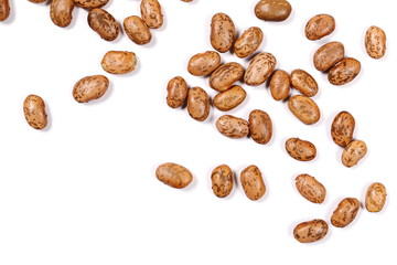Raw brown beans isolated on white background, top view